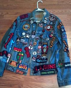 1980'S LEVI'S DENIM JEAN JACKET WITH MANY IRON-ON PATCHES OF ROCK BANDS