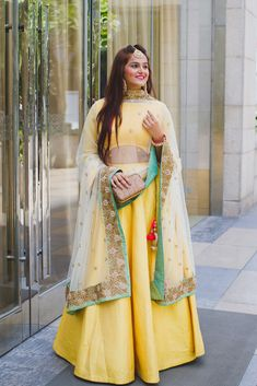 #YellowLehenga with a hint of mint for #Mehendi functions!   #Wedstreetstyle #wedmegood #weddingsutra #thecrimsonbride #wedding #indianmehendi #mehendioutfits  Blogger: What To Wear To A Mehendi Function For Brides & Wedding Guests