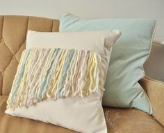 Make these easy fringe front pillows with yarn