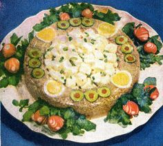 The Glistening Ring Of Horror.  A Frightening Jellied Veal Ring.  The precise placement of the olives, hard-boiled egg slices, and radish roses is essential to make this what it is.  (1945)