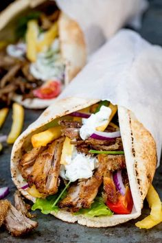 My favourite recipe for Crispy Pork Gyros with Homemade Tzatziki and how to get that perfect crispy-on-the-outside and tender-on-the-inside meat! Gyros Pita, Lamb Gyros, Chicken Gyros, Greek Recipes, Pork Recipes, Cooking Recipes, Lamb Gyro Recipe, Hamburgers, Slow Cooker