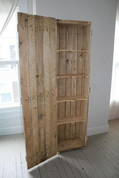 A cabinet/pantry made from wooden pallets.  Very cool!