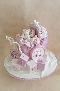 a Baby Carriage cake for a christening, complete with a script made of sugar with a prayer written on it specially whispered by the girl's parents on this special day