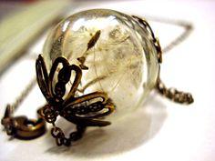 Real Dandelion Seeds Antique Style Bronze. Handblown glass orb, double bronze bead cap, long necklace. $23.90, via Etsy.