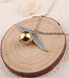 Silver Plated Harry Potter Golden Snitch Necklace #silver #harrypotter #goldensnitch #necklace #pendant #quidditch http://m.ebay.co.uk/itm/Free-Gift-Bag-Silver-Plated-Harry-Potter-Golden-Snitch-Wings-Pendant-Necklace-/282018789793?nav=SELLING_ACTIVE