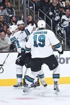 San Jose Sharks forward Joonas Donskoi celebrates a Sharks goal with linemate Joe Thornton and defenseman Brent Burns (Oct. 7, 2015).
