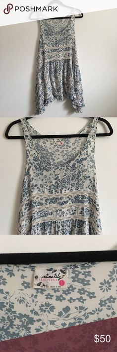 Free People Voile and Lace Trapeze Slip Free People Voile and Lace Trapeze slip in white with blue floral print. Can be worn alone as a dress or as a layering bohemian top, very versatile piece and a must have from Free People. It is in size small but is very loose and flowy. Has been worn only once. Feel free to ask any questions! Free People Dresses Mini