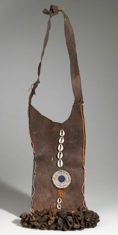 Africa | Apron from the Pokot (Suk) people of kenya | Leather, shell, hair, claw, pigment | 2nd half 20th century