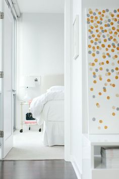 White bedroom and simple art work, c.a.p.
