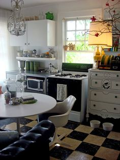 Love the use of dresser/couch in kitchen