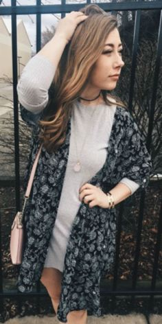 This chic grey dress is the perfect layering piece for any Valentine's Day outfit. The floral kimono, Kate Spade crossbody purse, drop necklace and black choker necklace all layer and work with each other to create this stylish ensemble.