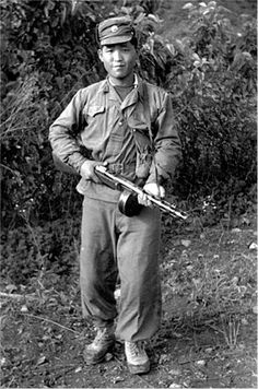North Korean soldier with Russian submachine gun (courtesy of George Gaspard)
