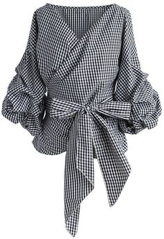 It's all in the details darling! The casually classic gingham print, dramatic bow and whimsical draping of this wrapped top make it a beautiful selection for a plethora of occasions.   - Decollete neckline - Ruche sleeves - Self-wrapped through keyhole on waist - 65% Polyester, 35% Cotton - Hand wash cold  Size(cm)   Length  Bust  Shoulder Sleeves XS                 57         84        Free           44 S                   57         88         Free           44 M                  58      …