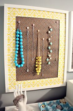 Necklace organizer using cheap decorative metal & frame, corkboard behind the metal & pushpins to hold up the necklaces.