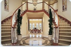 Every home needs a double staircase in the entry