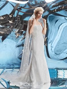 """Wedding Gowns by Helen Miller. Titled """"Ozon"""" this beautiful wedding dress from the Sky Collection features English tulle, and Calais lace. With a slight mermaid, this dress has 3D flowers and lace, lending itself to a truly romantic feeling."""
