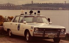 This Seattle PD 1974 Dodge Dart is pictured with Seattle's now-demolished King Dome. Photo courtesy of Seattle Police Museum. Old Police Cars, Army Police, Police Patrol, Rescue Vehicles, Police Vehicles, Cool Old Cars, Car Badges, Dodge Dart, Emergency Vehicles