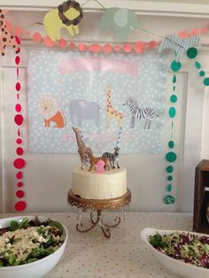 Zoo animals and polka dots Birthday Party cake and decorations! See more party planning ideas at CatchMyParty.com!