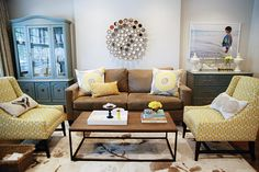 blow up photo for artwork with white frame, love it. and the yellow print chairs