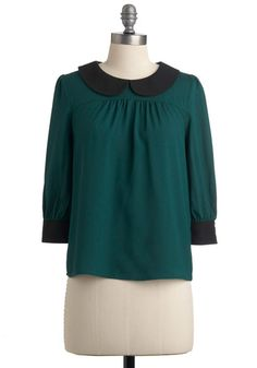 sheer-green trapeze top, gathered pleats, Peter Pan collar, black button cuffs