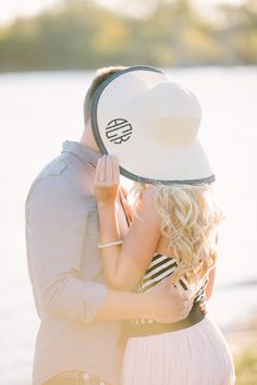 Cute pose for engagement pic. Love the monogrammed hat.