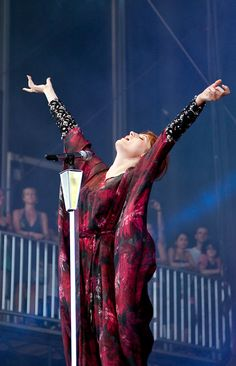 Florence Welch, embracing the moment on stage at #Lollapalooza! Did you see her crowd?