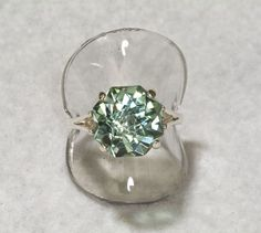 Prasiolite Green Amethyst  Rose Petal Cut 9 carat Alternative Engagement Ring. $250.00, via Etsy.