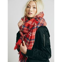 Cozy woven plaid scarf with fringe trim. Oversized for an endless drapey look and wrapping for days