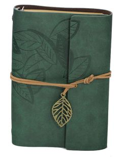 Embossed leaf design on the cover stretching around to the back of the book. Suede lining on the inside it holds a standard six ring mini binder that will accept standard journal or date book refill.