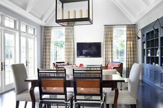 Betsy Burnham Design Beverly Hills modern Tudor. Like the curtains and mix of chairs with the table.