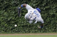 Los Angeles Dodgers right fielder Yasiel Puig can't make the diving catch on a double hit by Chicago Cubs' Cole Gillespie during the fourth inning of a baseball game on Friday, Aug. 2, 2013, in Chicago. (AP Photo/Nam Y. Huh)