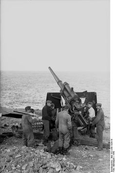 German soldiers in position with a  8,8cm Flak 36 cannon ( anti-aircraft). South France  1942