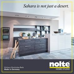 The Lux kitchen. High-gloss Sahara front. #kitchens #noltehomestudio #noltekitchens #noltehomestudioindia #india #modularkitchens #cabinets #worktop #luxeliving #home  Visit: www.noltehomestudio.in/kitchens