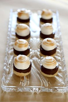 Smores Petit Fours, via Baking My Way. Meringue topping, over chocolate ganache, over graham cracker crust. Sounds great!