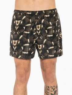Swimsuit allover snake from the S/S2014 Marcelo Burlon County of Milan collection in brown.
