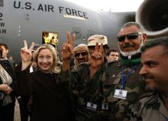 Hillary with the muslim brotherhood whom she and Obama helped take over Libya. Stop sharia law. This needs to be shown when she tries to run for President in 2016.  That is if Obama lets her and he continues to rule.