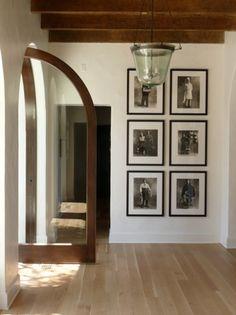 Door, wood beams, light fixture and contrasting beautiful flooring...all the elements of exquisite taste....