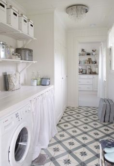 Lovely floor in laundry room. Home in Norway featured in the Bolig blog.