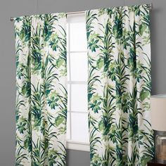 Tthis Bermuda bay palm leaf design with it's vibrant green sets a great tropic mood. Set on a cotton white twill cloth, the green colors really pop. This is a great window panel for any room.