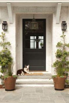 Love the lanterns, black, cover over door. Lucasstudioinc.com