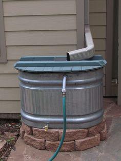 The Bicycle Garden: Setting up a galvanized stock tank as a rain barrel