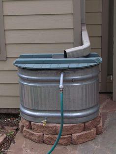 Setting up a galvanized stock tank as a rain barrel