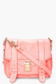 the girly color is such a great contrast against the masculine shape of the bag