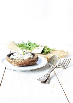 Portobello mushrooms stuffed with ricotta and tarragon.