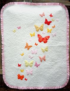 Make a baby blanket in no time at all with this simple baby quilt pattern. With butterfly applique and a pink ruffle trim, the Butterflies a Flutter Baby Quilt Pattern has a crisp white background, covered in free-motion quilting. Free Applique Patterns, Baby Quilt Patterns, Applique Quilts, Free Pattern, Quilting Patterns, Applique Templates, Embroidery Designs, Quilting Designs, Applique Designs