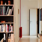Open shelving can cut both ways: Curate the air out of all your cool stuff and you're left with a gift shop, not a home; but beware piling everything into an open space for fear of a visual muddle. The residents of NHR strike a great balance of colorful activity without getting too precious. Neutral flooring, a dark wall help, and a blue Unfold pendant lamp from Muuto keep a sense of play without tipping into formless clutter.