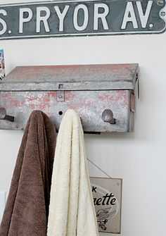 vintage mailbox as a towel holder in the bathroom...I love it!