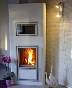 Tulikivi Lentua corner fireplace with bakeoven.