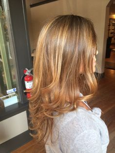Honey and Carmel blonde. Facebook: Hair by Shelby - Tryst Instagram: hair.by.shelby