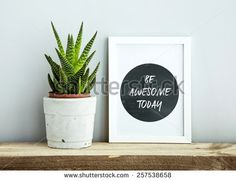 white frame  BE AWESOME TODAY  with succulent in diy concrete pot. Scandinavian hipster style room interior